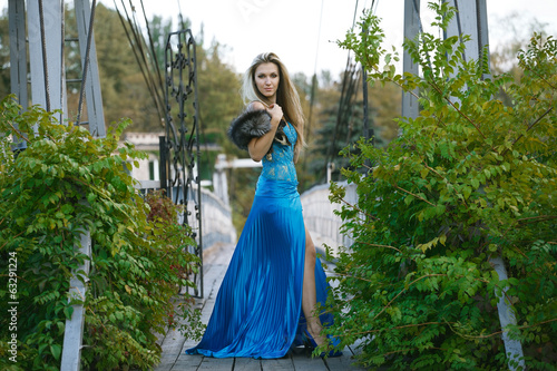 Beautiful blondy young woman wearing elegant blue dress