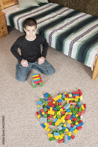 Boy playing with blocks low view