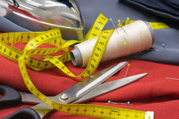 Thread Spools, Pin and Yellow Measuring Tape and Large Dressmaki