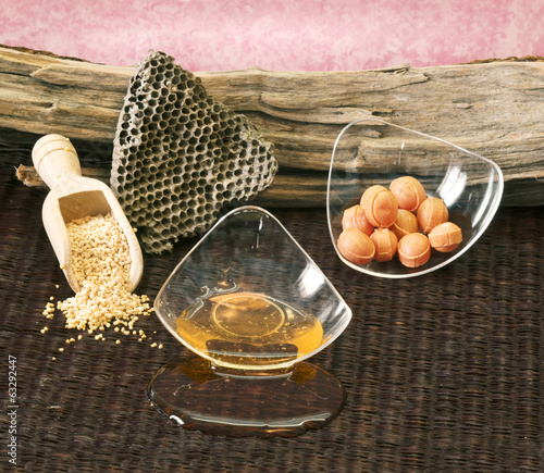 honey and pollen with beehive on wooden background