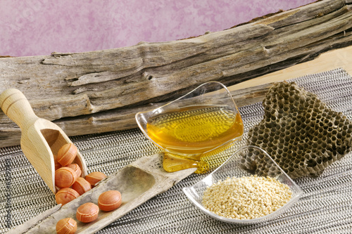 honey,pollen, beehiver anf honey bonbons on wooden background
