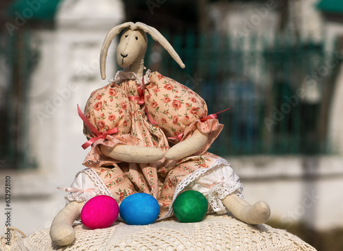Sewn hare with colored eggs at the Church