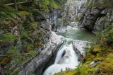 Maligne Falls through the narrow Maligne Canyon poster