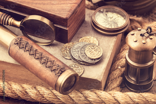 Old coins and nautical accessories
