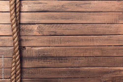 Rope on old wooden board vertical