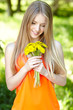 Spring girl with bunch of dandelions