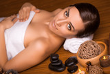 beautiful brunette in a massage parlor poster