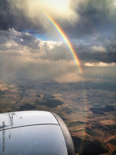 rainbow over the plane in the air