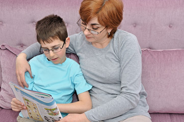 Woman and boy doing homework
