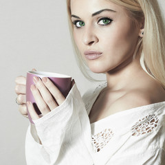 Beautiful Young woman drinking Coffee. Cup of tea. Hot drink
