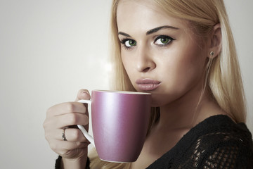 Beautiful blond woman drinking Coffee. Cup of tea. Hot drink