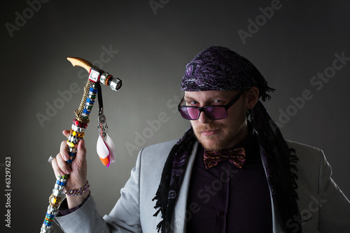 Red-haired bearded artist posing looking at camera