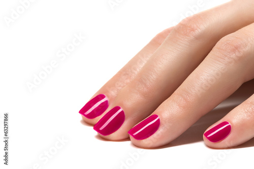 Woman hands with manicured red nails closeup