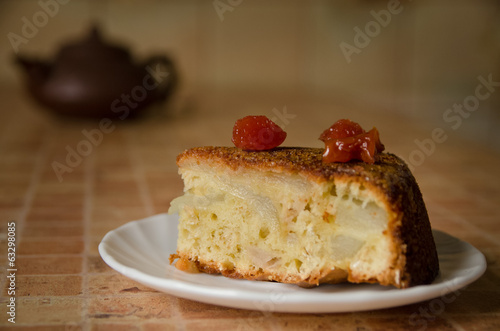 Slice of apple cake topped with cherries