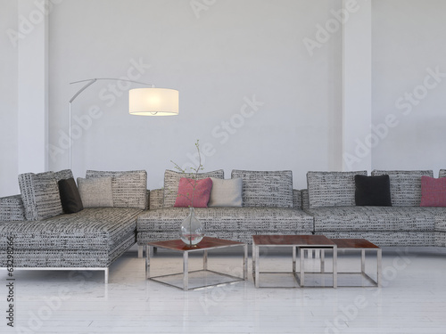Lounge interior with gray couch and tables