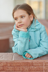 little girl in blue jacket