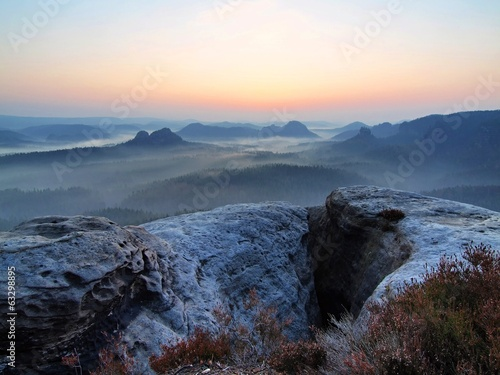 Waiting for daybreak in Saxony Switzerland rocky park.