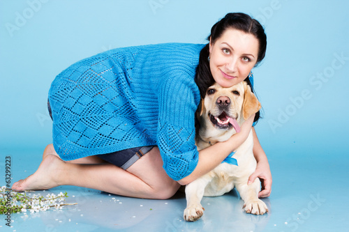 Pretty girl with her dog labrador