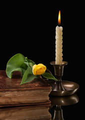 candle light  with flower on black background
