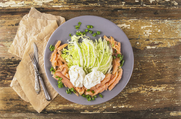 Poached eggs with green salad and salmon. copy space