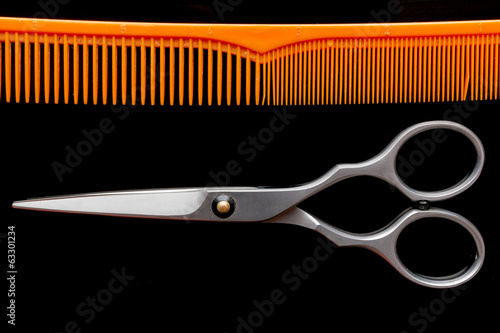 Hairdressing tool on isolated black background