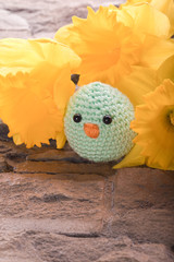 handmade chick with spring flowers as decoration