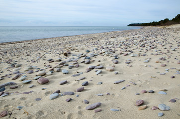 Pebbles at a sandy beach