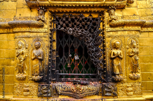 Detail of golden statues in buddhist and hindu temple, Kathmandu