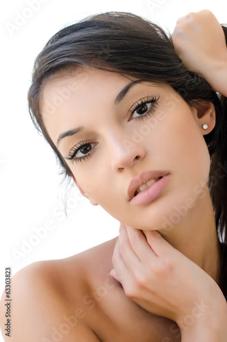 Portrait of a beautiful brunette girl holding her hair up.