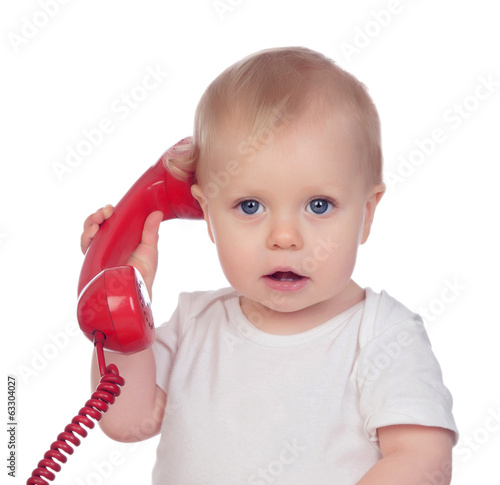 Beautiful baby with a red phone