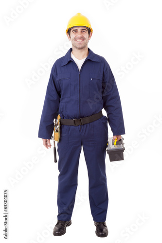 Full body portrait of a young builder holding a toolbox, isolate
