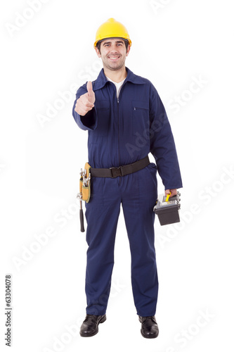 Young builder with thumb up, isolated on white
