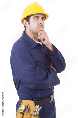 Thoughtful young worker over a white background