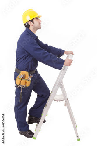 Worker climbing a ladder, isolated on white