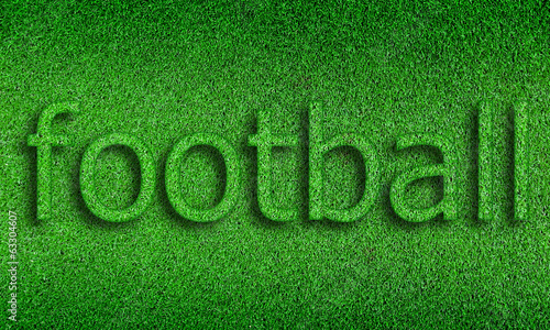 football  alphabet on green grass