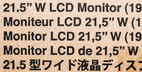 Standard monitor cardboard box with notes in diverse languages
