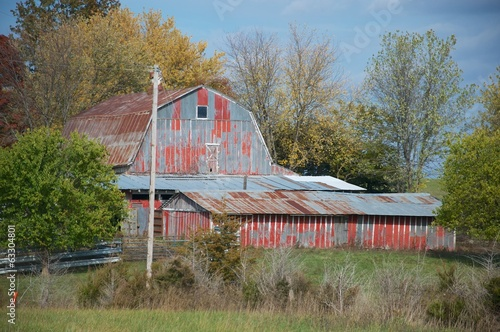 Faded red metal barns
