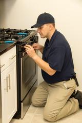 Service technician repairs oven
