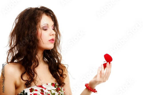 woman holding a present with engagement ring