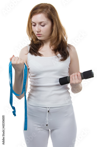 Girl with tape measure in her hands