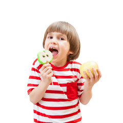 Cute little boy eats candy apple. Isolated on white background