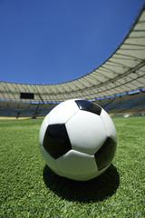 Football Soccer Ball on Green Grass Stadium Pitch