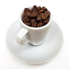 Cup with coffee beans on a white background