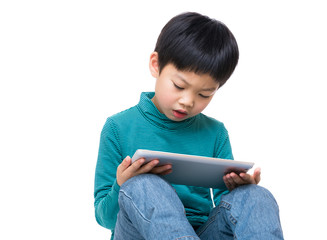 Asian little boy using tablet