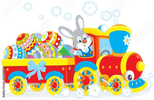 Easter rabbit on a train carrying Easter eggs