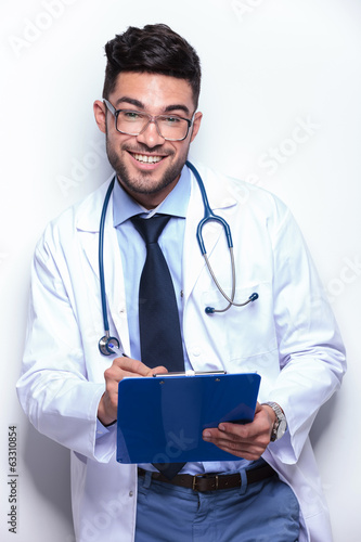 business man writes prescription