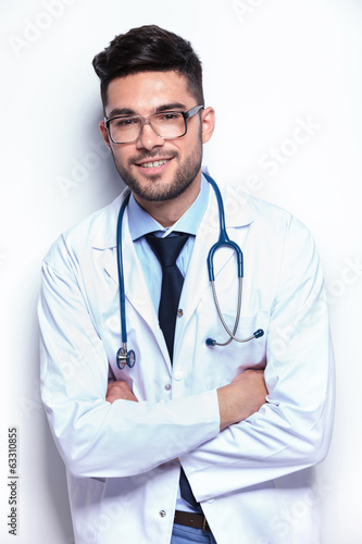 young medic with hands crossed