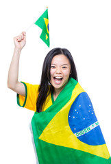 Excited asia female football supporter holding small Brazil flag