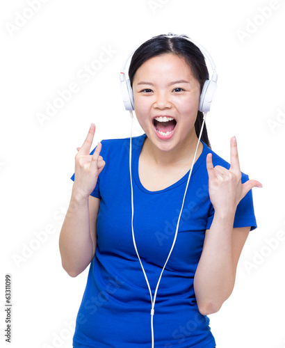 Asia woman enjoy listen to music