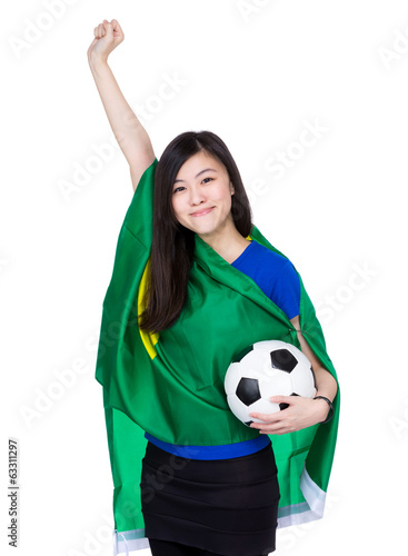 Asia excited woman drape with Brazil flag and football